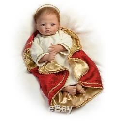 A Savior Is Born baby doll in Manger by The Ashton-Drake Gallery