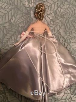 Ashton Drake Gene Love Paris doll wearing ooak gown of repro centerpiece