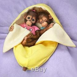 Frankie & Fiona Twin Monkey Doll Set with Fleece Banana Bunting by Ashton Drake